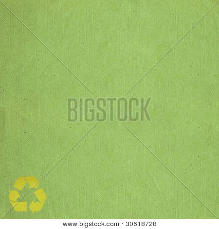 Green Paper Background Texture With Recycle Sign
