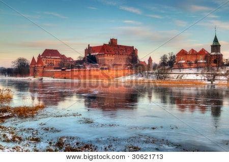 Teutonic castle in Malbork with frozen Nogat river, Poland