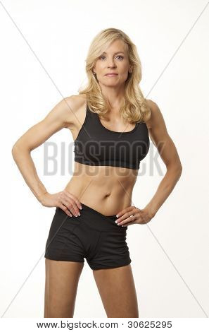 Attractive blonde fitness model isolated against white background.