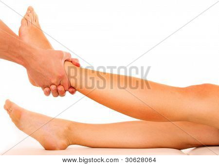 A picture of a physio therapist giving a leg massage over white background