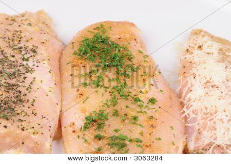 Three Raw Chicken Breasts