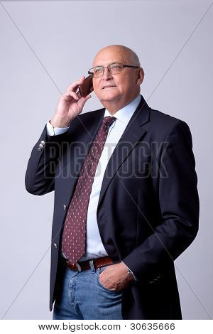 successful senior man with phone