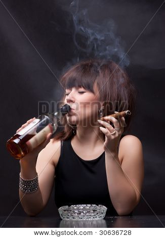 woman drinks alcohol and smokes a cigar