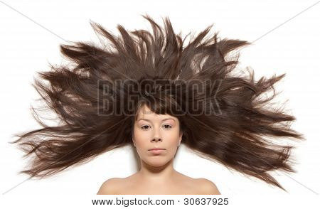 Woman with long hair straightened on the floor around the head