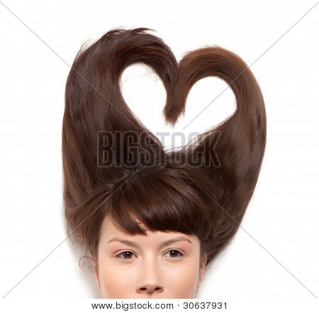 woman with long hair lying in the form of heart