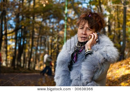 woman in a gray coat in the park