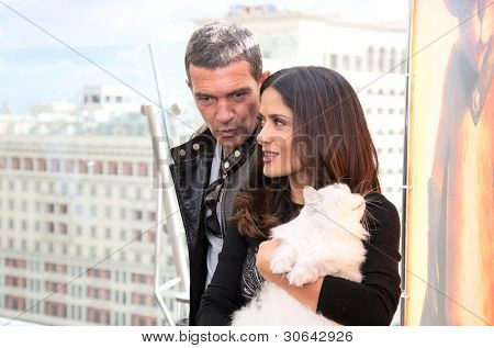 """MOSCOW - JULY 16: Antonio Banderas and Salma Hayek arriving at the """"Puss In Boots"""" Premiere at the Ritz Hotel Moscow on July 16, 2011 in Moscow, Russia"""