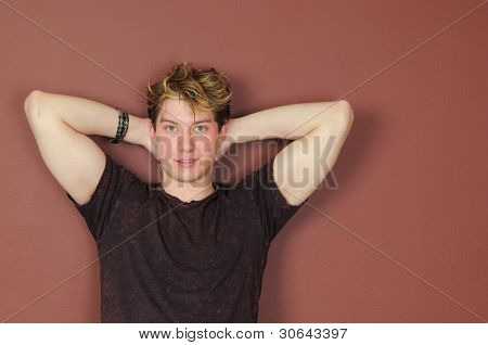 Handsome Young Man With His Hands Behind His Head