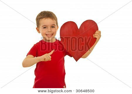 Happy Kid Pointing To Heart Shape
