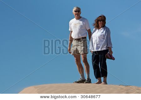 Active Retired couple at the dunes
