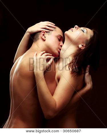 A passionate couple, isolated on brown