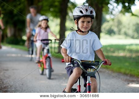 4 Years Old Boy Riding A Bicyle