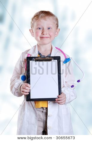 Smiling Little Boy In Doctor Uniform