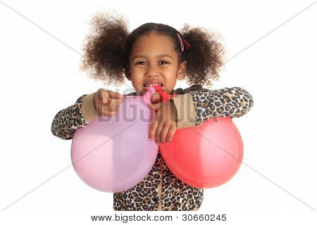 African American Child And Asian Long Hair With Ball In Mouth Isolated