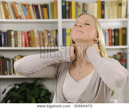 Portrait of young woman suffering from severe neck pain