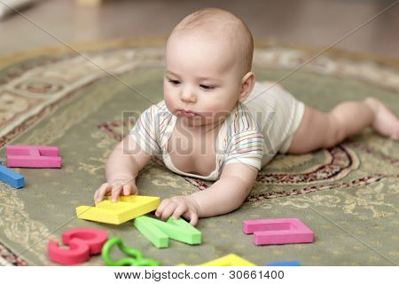 Baby Playing With Alphabet