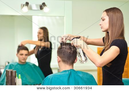 Hairdresser dries the hair guy