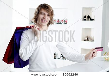 Man At Shopping Checkout Paying Credit Card