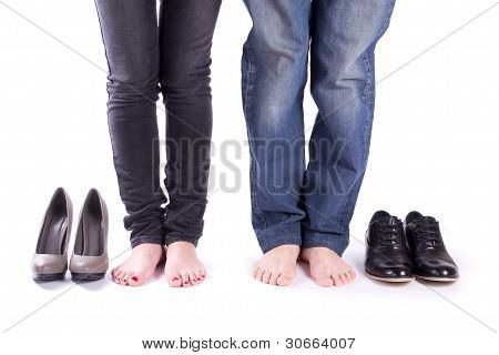 Man and a woman barefoot around their shoes