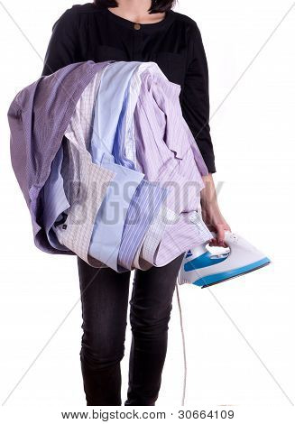 Woman holding a shirt and iron