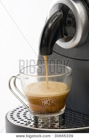 Espresso machine dispensing coffee into a glass cup