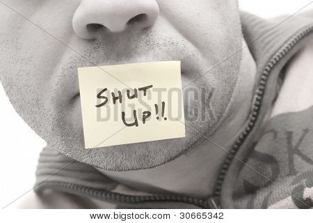 "a post it in a man mouth saying ""Shut Up...!!"""