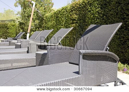 Detail of gray chairs at a Luxury resort swimming pool