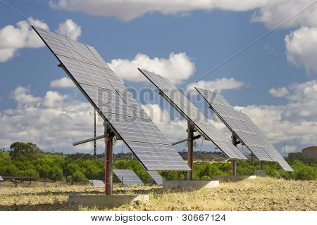 Solar panels aligned and faced to the sunlight at a ecology park (Blue and alternative energy)