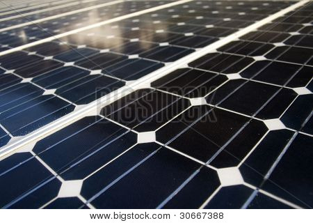 Texture detail of photoelectric cells of a solar panel (Blue and ecology energy)