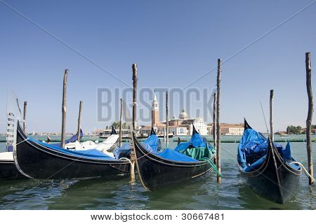 Gondolas on Grand Canal in front of San Giorgio Maggiore church at Venice, Italy