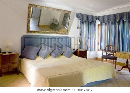 Classical style and elegant decorated sleeping room (bedroom) with a big mirror