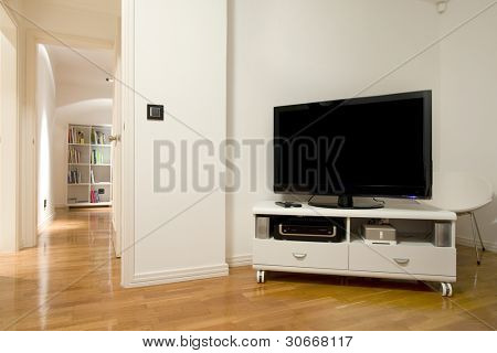 Detail of Plasma TV in a sleep room (bedroom) interior with open door to corridor