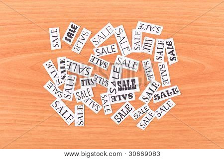 Pieces of paper with inscription SALE