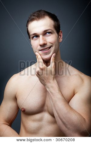 Muscles or brain concept - muscular man thinking