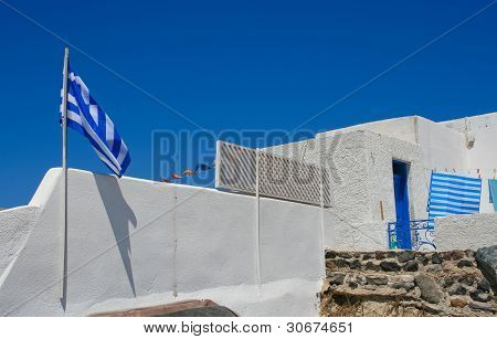 White Old Street In Santorini With Greece Flag