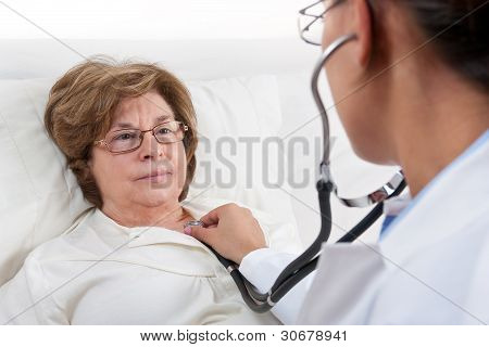 Doctor Examining Senior Patient