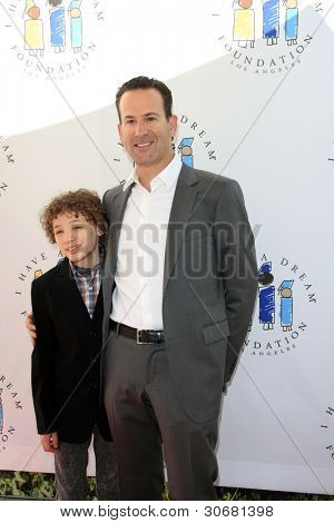 LOS ANGELES - MAR 4:  Maxim Knight, Darryl Frank arrives at the  Have A Dream Foundation's 14th Annual Dreamers Brunch at the Skirball Cultural Center on March 4, 2012 in Los Angeles, CA