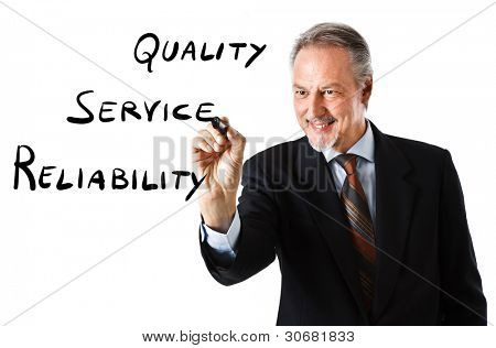 Businessman writing business goals on the screen