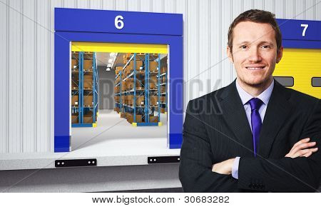 smiling businessman and 3d warehouse background