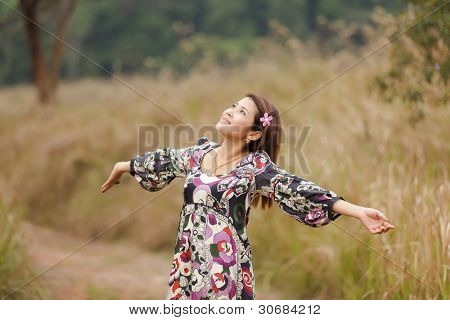 woman breathing in wild nature park, thailand