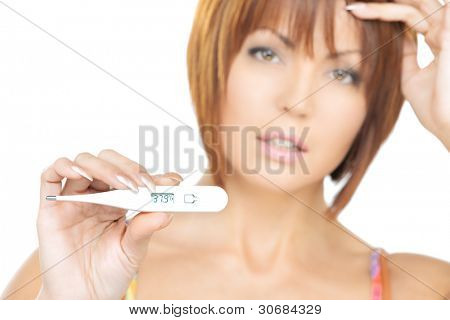 bright picture of unhappy woman with thermometer