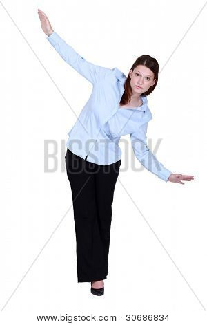 Woman walking along invisible tight-rope