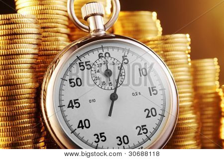 stop watch with stack of coin