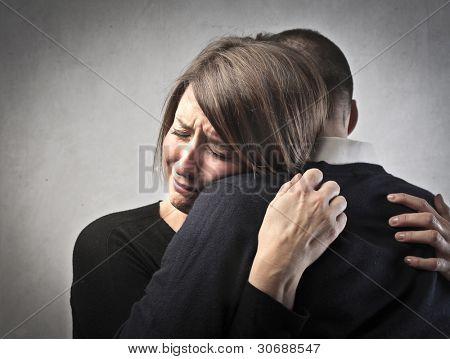 Sad woman hugging her husband
