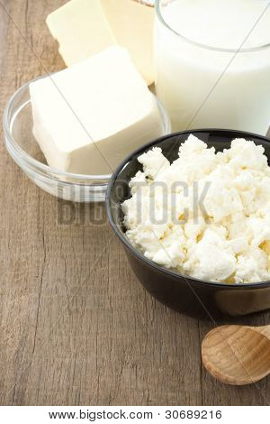 milk products on wood background texture
