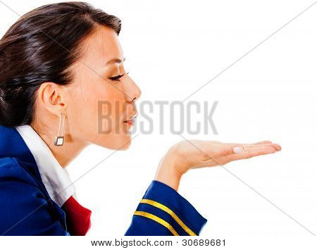 Flight attendant blowing into her hand - isolated over white