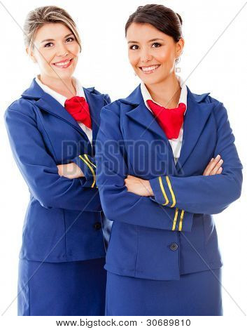 Beautiful flight attendants smiling - isolated over a white background