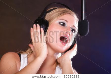 Woman Singing Rock Song Microphone Headphones