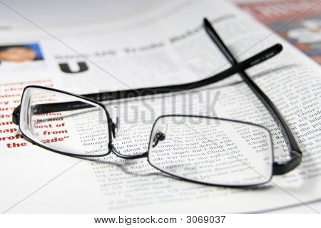 Glasses And Business Magazine