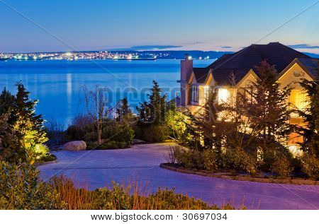 Luxury house with gorgeous night ocean view in Vancouver, Canada.